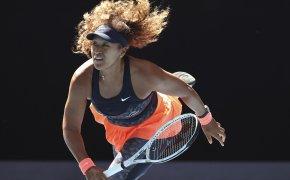 Naomi Osaka following through on a serve during a match at the 2021 Australian Open.
