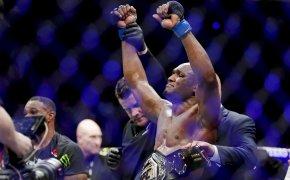 Kamaru Usman celebrates a title defense in the Octagon