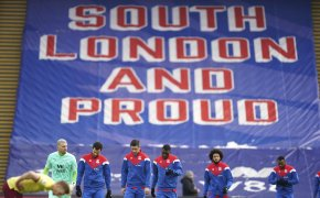 Crystal Palace players arriving and walking on the field ahead of their English Premier League soccer match.