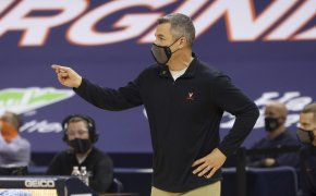 Virginia coach Tony Bennett calling a play from the sidelines during a NCAA men's basketball game.