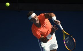 Rafael Nadal with a follow through on his serve during a match at the 2021 Australian Open.