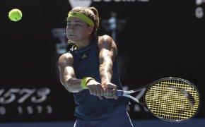 Karolina Muchova hitting a backhand return during a tennis match.