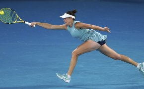 Jennifer Brady stretching for a forehand return during a tennis match at the Australian Open.