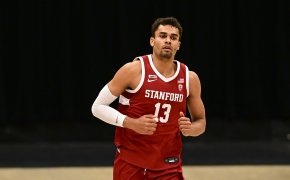 Stanford forward Oscar da Silva jogging on the court during a game.