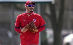 St. Louis Cardinals infielder Nolan Arenado smiles as he jogs out to his position during spring training