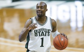 Michigan State guard Joshua Langford dribbling the ball up the court during a game.