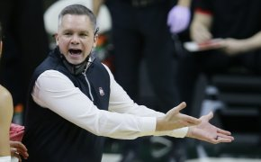 Chris Holtmann mask down yelling with officials