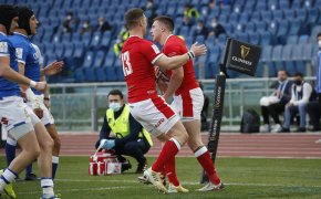 Wales players celebrate a try scored against Italy