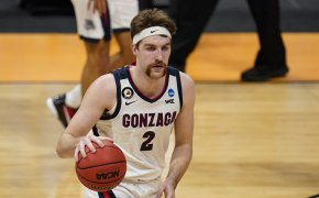 Gonzaga forward Drew Timme dribbling the ball during a NCAA March Madness game.