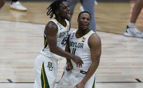 Baylor's Davion Mitchell and Mark Vital celebrating