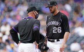 Austin Gomber talking to the Rockies' pitching coach on the mound