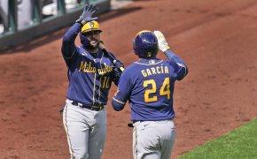 Avisail Garcia and Omar Narvaez high-five