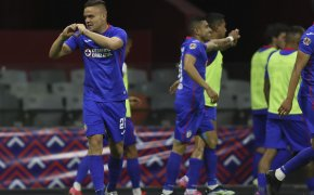 Cruz Azul's Jonathan Rodriguez celebrating after scoring a goal during a soccer match.