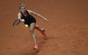 Simona Halep hitting a forehand return during a tennis match.