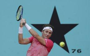 Casper Ruud hitting a backhand return during a tennis match.