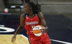 Tina charles dribbling basketball