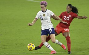 Megan Rapinoe and Jayde Riviere battle for ball