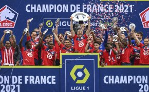 Lille players posing with the trophy celebrating winning the French League One Soccer.