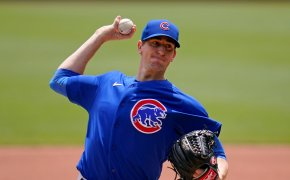 Chicago Cubs starting pitcher Kyle Hendricks throwing a pitch during a baseball game.