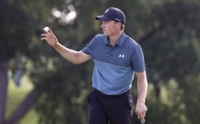 Jordan Spieth waving to fans while on the green during the third round of the Charles Schwab Challenge golf tournament.