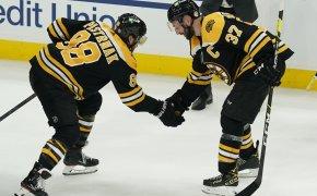 David Pastrnak, Patrice Bergeron, Boston Bruins celebrate