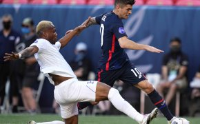 United States' Christian Pulisic moving the ball against Honduras' Kevin Alverez during the first half of a CONCACAF Nations League soccer match.