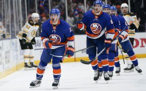 New York Islanders' Mathew Barzel celebrating with teammates after a goal during a NHL playoff game.