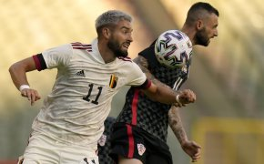 Yannick Carrasco going after ball against defender