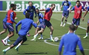 England players controlling the ball during a training session.