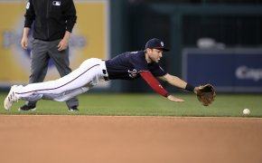 Shortstop Trea Turner diving for a ball during a MLB game.