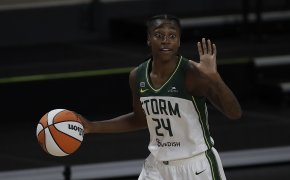 Jewell Loyd dribbling ball with hand up