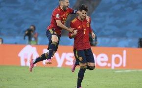 Spain's Alvaro Morata and Jordi Alba celebrating after scoring a goal during a soccer match.