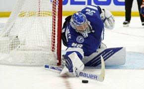Tampa Bay Lightning goaltender Andrei Vasilevskiy making a save during a NHL game.