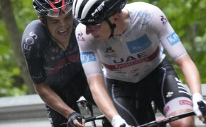 Richard Carapaz following Tadej Pogacar during the eighth stage of the Tour de France.