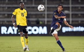 Costa Rica midfielder Bryan Ruiz clearing the ball away from the opposing team players.