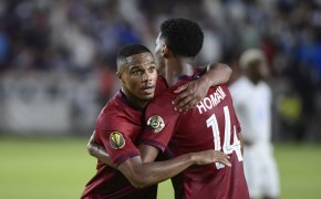 Qatar players embrace on the pitch