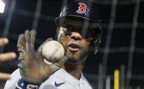 Xander Bogaerts holding a baseball