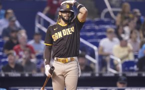 San Diego Padres' Fernando Tatis Jr adjusting between pitches