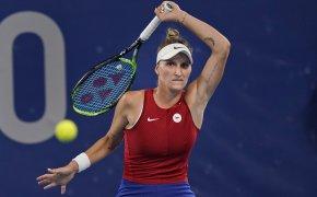 Marketa Vondrousova hitting a return against Naomi Osaka during a match at the Olympics.