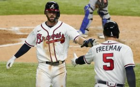 Atlanta Braves' Dansby Swanson celebrates with Freddie Freeman
