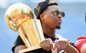 Kyle Lowry holding NBA title