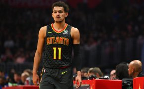 Trae Young standing at scorers table