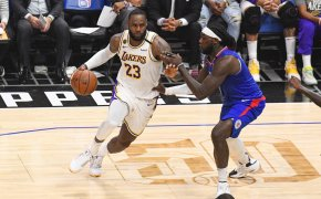 Lebron James driving to the basket against LA Clippers Montrezl Harrell