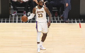 LeBron James holding ball with right hand looking to pass