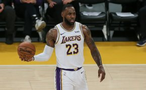 LeBron James holding ball with one hand