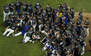 Los Angeles Dodgers pose for a group picture after defeating the Tampa Bay Rays 3-1 to win the 2020 World Series