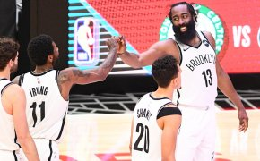 Kyrie Irving celebrating with James Harden