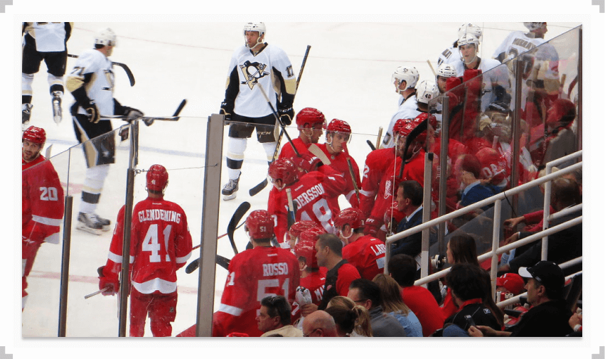Players on ice in game between Pittsburgh Penguins and Detroit Red Wings