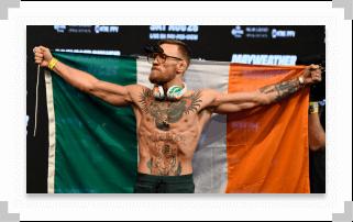 Conor McGregor holding Irish flag behind his back