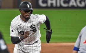 Chicago White Sox outfielder Luis Robert runs to 3rd